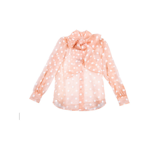 Peach colored shirt with...